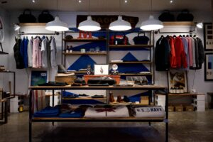image of shirts, hats and other swag in a store